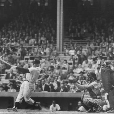 Yankee Mickey Mantle in Action, Swinging Bat with Catcher and Umpire Behind Him by Grey Villet