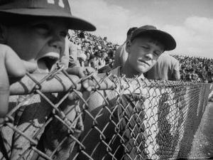 Young Fans Standing at Fence Which Borders Field at World Series Game, Braves vs. Yankees by Grey Villet