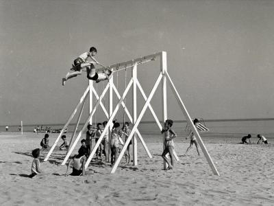 Group of Children Playing on a Swing on the Beach-A^ Villani-Photographic Print