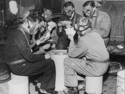 Group of Men Playing Cards, Wearing Gas Masks--Photographic Print