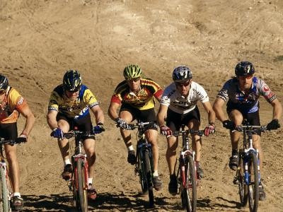 Group of People Riding Bicycles in a Race--Photographic Print