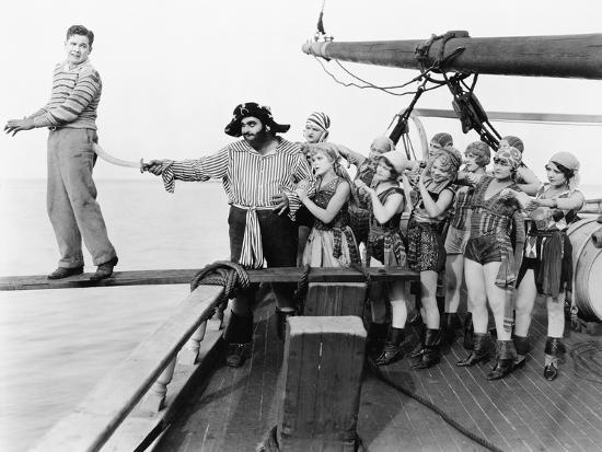 Group of Pirates Trying to Push a Young Man over a Plank--Photo