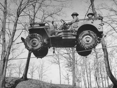 Group of Us Soldiers Pulling a Jeep over a Ravine Using Ropes while on Maneuvers-William C^ Shrout-Photographic Print