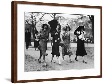 Group of Women Walking With Umbrellas, Circa 1930's--Framed Photographic Print