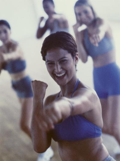 Group of Young Women Exercising in a Gym--Photographic Print