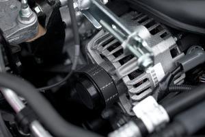 Generator And Fan Belt In A Car Engine by Gudella
