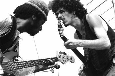 https://imgc.artprintimages.com/img/print/guitarists-david-brown-and-carlos-santana-during-music-and-art-festival-in-woodstock-august-1969_u-l-pwgit90.jpg?artPerspective=n