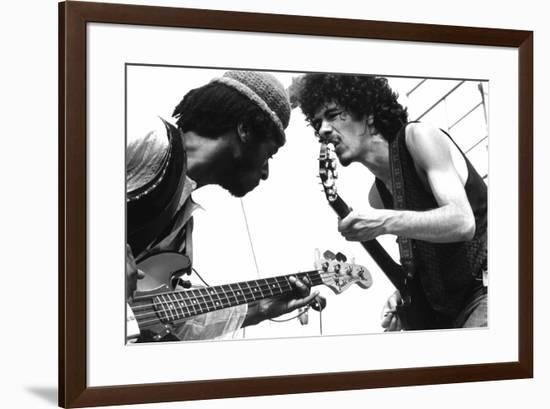 Guitarists David Brown And Carlos Santana During Music And Art Festival In Woodstock, August 1969--Framed Photo