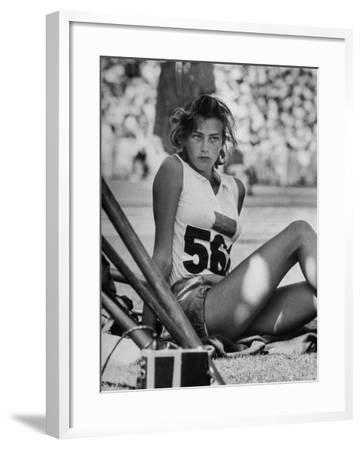 Gunhild Larking, Sweden's Entry for High Jump, Nervously Awaiting Turn to Compete at Olympic Games-George Silk-Framed Premium Photographic Print