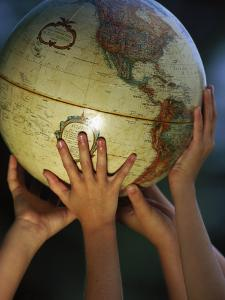 Kids Holding Globe by Guy Crittenden