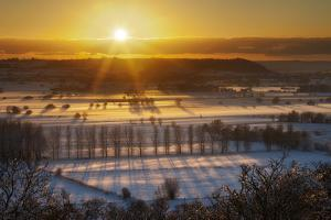 Winter Sunset over the Somerset Levels on a Misty Evening with Snow on the Ground. Somerset, UK by Guy Edwardes