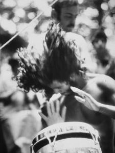 Guy Playing Drums at Woodstock Music Festival