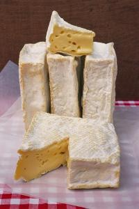 Slices of Pont L'Eveque Cheese by Guy Thouvenin