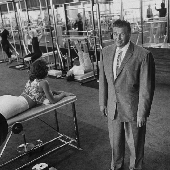 Gym owner vic tanny in one of his 60 gyms photographic print by
