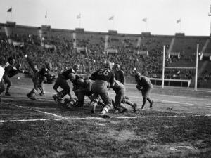 American Football Game, Running Back Heading Into Group of Blockers by H^ Armstrong Roberts