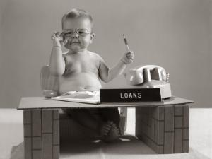 Baby at Desk Playing Loan Officer by H. Armstrong Roberts