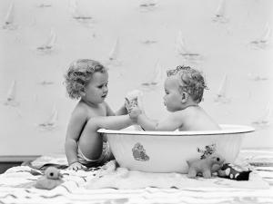 Baby Boy Sittings in Wash Tub, Washing Feet of Girl Sitting Outside of Tub by H. Armstrong Roberts