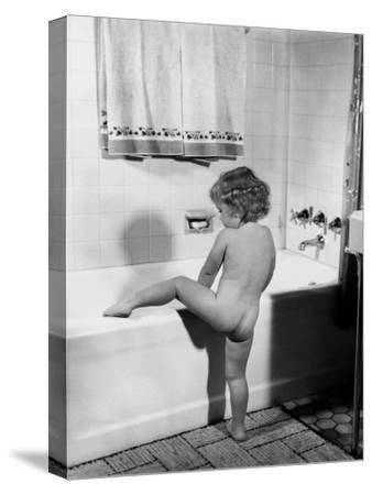 Baby Girl Climbing Into Bath Tub