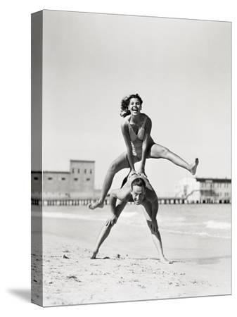 Couple Playing Leapfrog