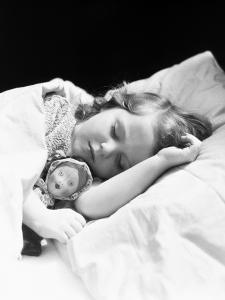Girl Sleeping, Head on Pillow, Baby Doll Toy Under Arm by H^ Armstrong Roberts