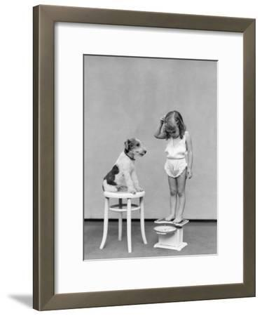 Girl Standing on Scales, Reading Weight, Terrier Dog Sitting on Stool