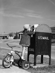 Girl Standing on Tricycle on Suburban Sidewalk, Mailing Letter in Mailbox by H^ Armstrong Roberts