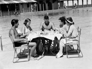 Group of People Sitting Poolside at Hotel, Eating Dinner, Miami, Florida by H^ Armstrong Roberts