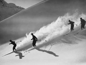 Group of Skiers Descending Alpine Slope, People in Silhouette by H^ Armstrong Roberts