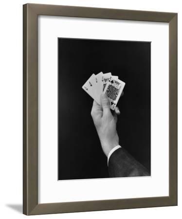 Man's Hand Holding 'Full House' Poker Card Hand