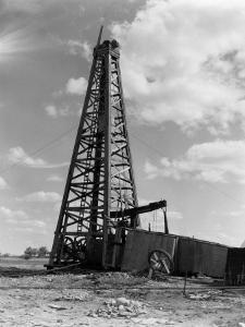 Oil Well With Wooden Derrick, Near Houston, Texas by H^ Armstrong Roberts