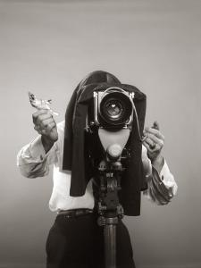 Photographer Behind View Camera Holding a Birdy by H^ Armstrong Roberts
