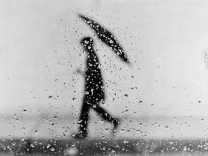 Silhouette of Man Carrying an Umbrella, Walking in the Rain by H^ Armstrong Roberts