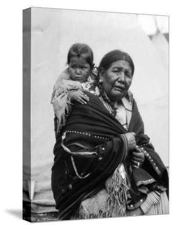 Sioux Woman Carrying Baby in Papoose on Back