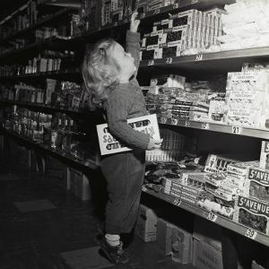 Toddler in Candy Aisle of Store by H^ Armstrong Roberts