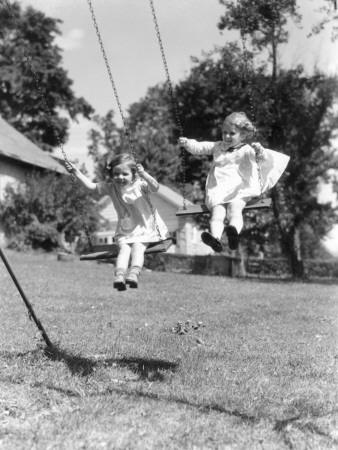 Two Girls on Backyard Swing Set Swinging Playing Fun Summer