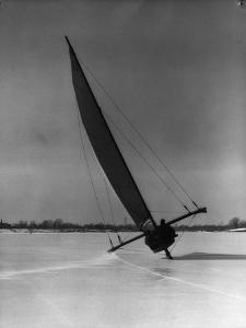 Two Men Sailing Boats With Runners on Frozen Lake, New Jersey by H^ Armstrong Roberts