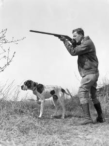 Upland Bird Hunter With Pointer Dog, Taking Aim by H. Armstrong Roberts