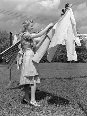 Woman, Housewife, is Outdoors, Hanging Clean Fresh Laundry on Clothesline