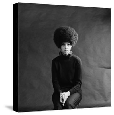 Young African-American Woman With Afro, Looking Sad