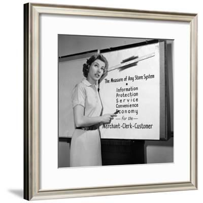 Young Career Woman Giving Business Presentation, Pointing at Poster