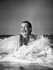 Young Woman Lying in Surf, Laughing by H^ Armstrong Roberts