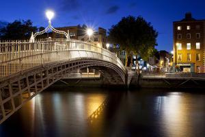 Ha'Penny Bridge Lit Up at Dusk, Liffey River, Dublin, Leinster Province, Republic of Ireland