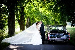 Bride and Groom in Car by HalfPoint