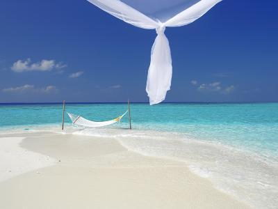 Hammock Hanging in Shallow Clear Water, the Maldives, Indian Ocean, Asia-Sakis Papadopoulos-Photographic Print