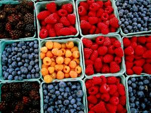 Raspberry, Blueberry and Blackberry Punnets at Farmers Market by Hanan Isachar