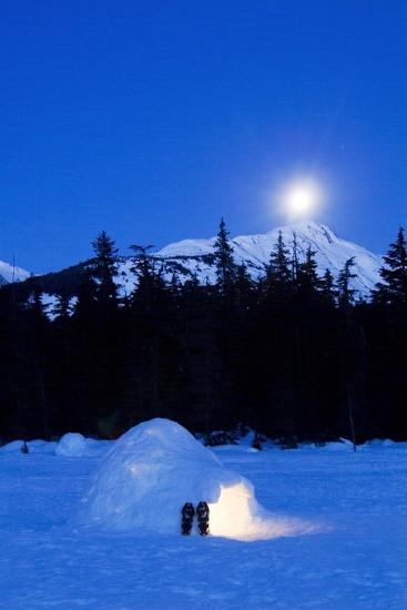 Hand Built Igloo in Moonlight Lit Up with Snowshoes at Entrance Glacier Valley Girdwood Alaska-Design Pics Inc-Photographic Print