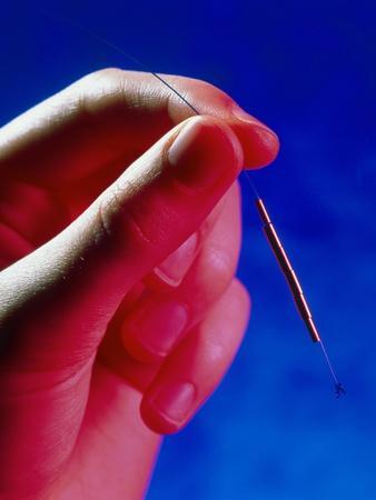 https://imgc.artprintimages.com/img/print/hand-holds-a-gynefix-intrauterine-contraceptive_u-l-pzjx4j0.jpg?p=0