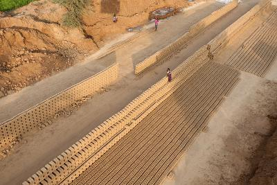 Hand Made Bricks Laid Out on the Ground to Dry before Baking, Northeast of Jaipur, Rajasthan, India-Annie Owen-Photographic Print