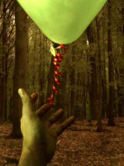 Hand Reaching for Balloon in Forest-Abdul Kadir Audah-Photographic Print