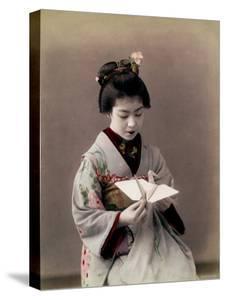 Hand Tinted Photograph of Japanese Dancing Girl Making Paper Bird
